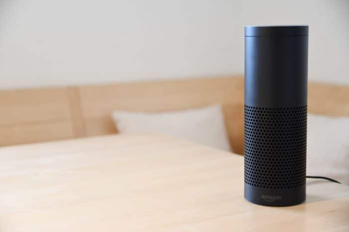 black amazon echo on table with alexa